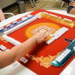 four people playing mahjong